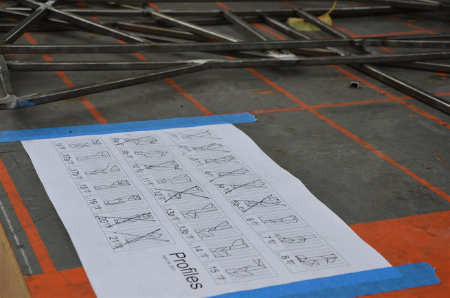 We check off the pieces that we have fabricated on the master drawing.