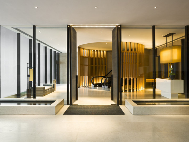 "Since the hotel starts higher up in the hotel, the approach at street-level is understated, with just a small entry lobby tucked into a corner of the highrise footprint. Fu's inspiration for the hotel was a ""modern-Oriental residence, designed with respec"