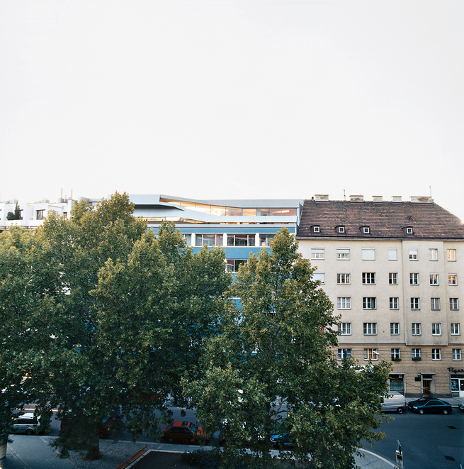 The penthouse is boldly inserted within the traditional rooftops in Vienna's Wieden district.