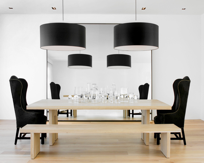 <p>The kitchen opens up to the dining room, where Hollis played with size and shape. She designed the solid French oak dining table and bench, which were fabricated by B Serota Furniture and Architectural Design, and flanked the table with a Host and Host