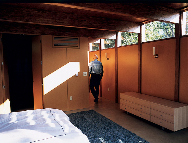The house's interior walls are medium-density fiberboard, the sort of material that more typically is covered with drywall. Instead, the fiberboard was coated with a linseed oil to accent its natural, rich tan and finished with a catalyzed var-nish to mak