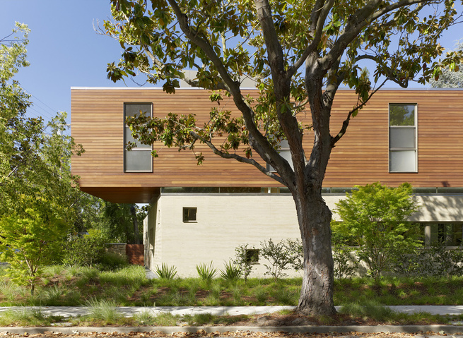 """This was the most complex house I've ever done,"" says Smith of the residence, which is located on a corner lot in a quiet residential neighborhood in Palo Alto. Though the facade shown here faces the street, it is actually the back of the home. Making al"