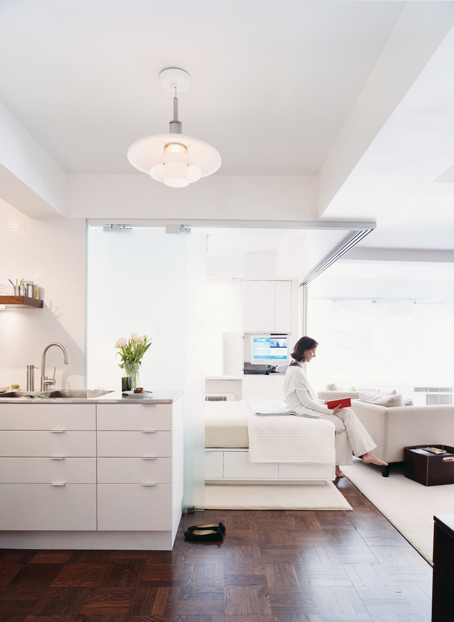White New York apartment with sleeping nook and parquet flooring