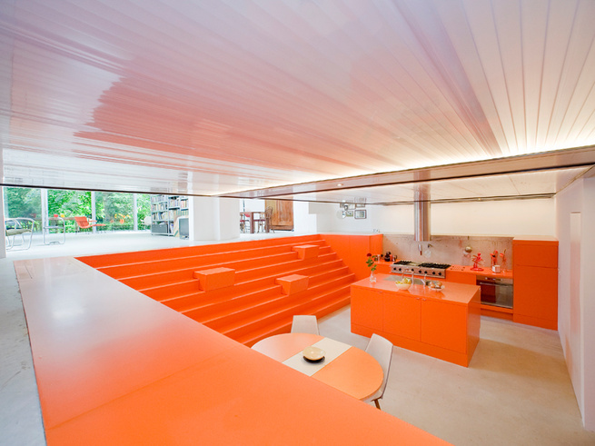Modern dugout with neon orange stairs