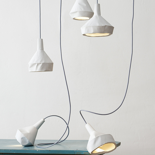 "Thought these lamps by <a href=""http://aust-amelung.com/"">Miriam Aust and Sebastian Amelung</a> appear to be featherweight paper, they're actually concrete!"