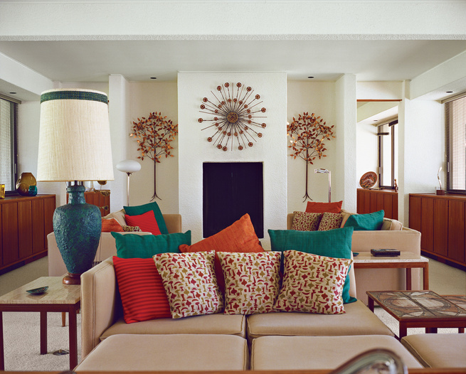 Modern living room with printed pillows and original 1980 carpeting