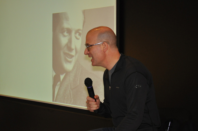 Pardo onstage with Knoll founder, Hans G. Knoll, on the screen behind him.
