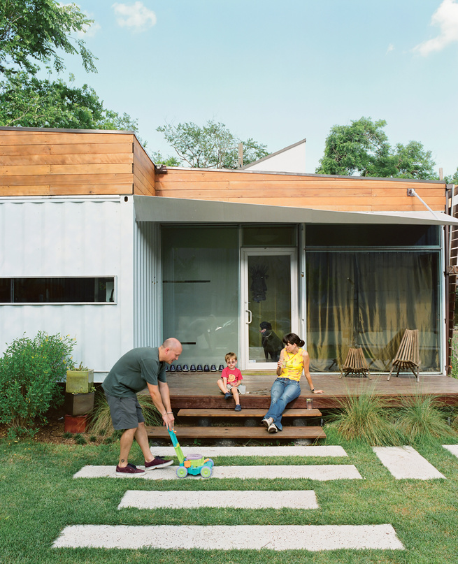 """One of the main draws of Kevin Freeman and Jen Feldmann's house is its connection to the neighborhood, which is why the front porch was a must. """"Homes that have a door but no outside space say, 'I'm not interested in you,'"""" designer <a href=""""http://robdes"""