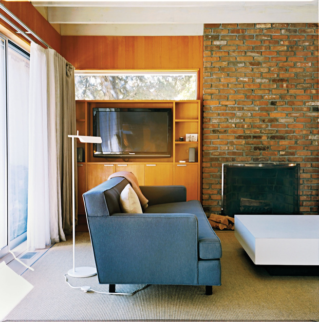 Living room with Tab F1 floor lamp from Flos and steel blue Dunbar sofa