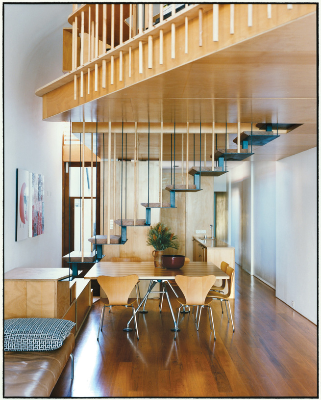 Dining area view of steel staircase with recycled blackbutt wood treads