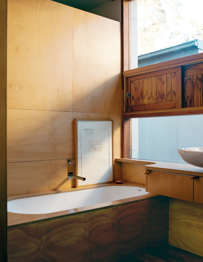 Modern traditional Japanese-style bathroom clad in wood