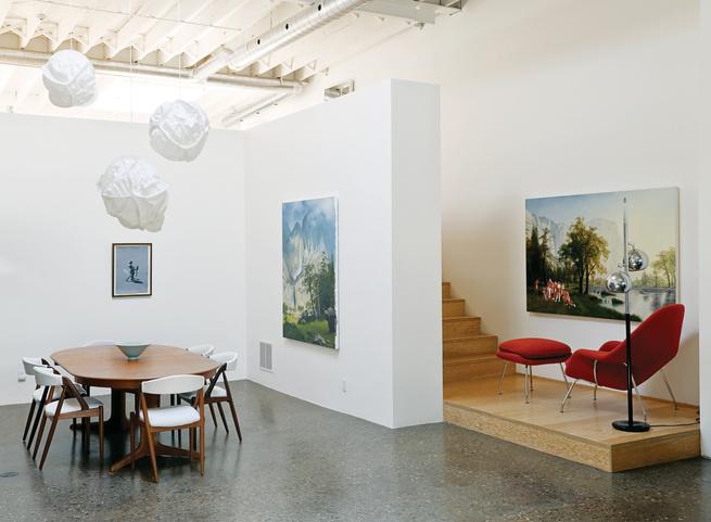 Live work space with Eero Saarinen Womb chair and vintage silver floor lamp