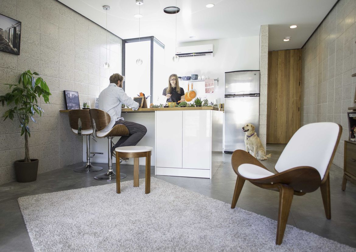 Phoenix small apartment with Ikea rug and Hans Wegner chair