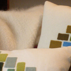 Topping the Cubert Love Seat by 608 Design is a pair of Storeys Cushions by Kerry Croghan.
