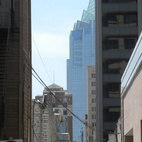 To find some shade, we walked down some of Austin's narrow downtown alleys. In the distance is the Frost Bank Tower.  Photo by: Miyoko Ohtake