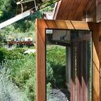 Architect Jenda Michl of Vertu Studio designed a new screen door and glass awning to enhance views of the mountains from his parents' house in Boulder, Colorado. Photo by Daniel O'Connor.  Courtesy of 2011 Daniel O'Connor / danieloconnorphoto.com.