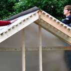 "Pictured here are two of the students at work on the Chicken Chapel. ""They were great,"" Moskow says. ""It'd be sunny in the morning then there'd be a rainstorm in the afternoon, but no one complained. It took really, really long days to finish it but they were gung-ho to get it done and were very proud of it at the end."""