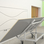 In this image, the table's legs have been removed and placed on their respective hanging hooks.
