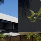 """The corner site is surrounded by car garages and old adobe houses. """"What makes the project interesting is that it tries to recover a little green area in the middle of this industry,"""" Ortiz de Zevallos says."""