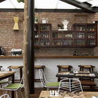 """""""The focus is on the working counter,"""" Ortiz de Zevallos says of the space where shellfish and seafood dishes are served to eager crowds. Throughout the dining area, the floor is made of recycled wood."""