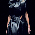 Here's a synthetic leather skirt and top by Kawakubo for Comme des Garcons from the Spring/Summer 2009 line. Pret-a-porter it's not. At least not the headpiece.  Courtesy of                                                       .
