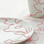 1999Embroidered Tablecloth continues patterns derived from Ming vases across plates and cups.  Photo by: Oliver Mark