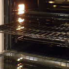 GE Monogram's ovens, like many new ovens, featured roll-out racks that extend all the way out for easier use.