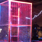 The Fiesta Hall's main attraction was the Tesla Stage. Here, Austin-based group ArcAttack! set up its Tesla coils and Faraday cage. The coils create electricity, which become electrical arcs, which look like lightning bolts. Where the arcs connect to the Faraday cage and panels determines the sound they make. ArcAttack! created its own DJ setup to play songs by adjusting the voltage of the arcs so that they produce tones in certain patterns (like in the end of the Nicolas Cage flick The Sorcerer's Apprentice). It was pretty awesome to see and hear.  Photo by: Miyoko Ohtake