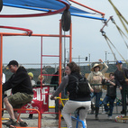 There were lots of solar- and human-powered projects to see. The parents of the four kids on this Cyclecide swing ride powered it by riding stationary bicycles.  Photo by: Miyoko Ohtake