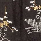 Outer kimono, monochrome figured satin silk with tie-dyed and embroidered decoration. Japan, 1800-30 (V&A: FE.28-1984). From V&A Pattern Series II: Kimono published by V&A Publishing and Abrams Books.