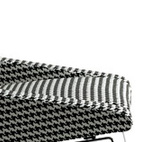 Designed by Mârten Claesson for Swedese, the Gran Turismo Easy Chair features a houndstooth-like pattern over a solid wood and steel frame.