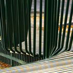 Steel and wood are the main materials here, and the seemingly billowing metal gives the illusion of a fence in motion.  Courtesy of Herbert Wiggerman.