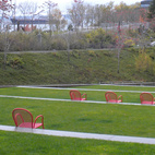 Under protection of the cantilevered roof of the PACCAR Pavilion, it was again the red chairs on the stepped, outdoor amphitheater—as well as Calder's sculpture that matched—that caught my attention. From the distance, Serra's sculpture appears much smaller.