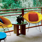A screened-in porch overlooks the pond and sports furniture by both Harry Bertoia and Dow himself.Photo by: Balthazar Korab