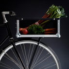 """""""The bike crate is designed and built for every day use. It is spacious and sturdy and meets the demands arising from a busy urban lifestyle. Due to its size and form it is more versatile in use than even the big classical bicycle baskets. The materials used can withstand everyday use and all kinds of weather. The bike crate is made of dibond, stainless steel, and polycarbonate, and all brackets are custom crafted in lightweight aluminum. The corner brackets can withstand even strong impacts."""""""