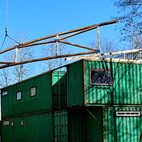 "Here, the roof structure is lifted atop the containers. ""The exterior of the building will be painted with WeatherBloc-IC by Mascoat – this paint contains ceramic and silica particles encased in a latex emulsion. When sprayed on it will help insulate the building by reducing the radiant and conducted heat,"" says Cherubini of his efforts to keep the building as green as possible. Photo ©2011 epic software group, inc."