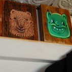 Faces on wood blocks line the ceiling.  Photo by: Bradford Shellhammer