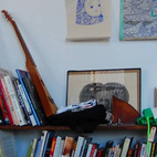Artwork, books, and musical instruments live in every nook of the workshop.  Photo by: Bradford Shellhammer