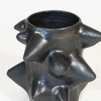 """One of the pieces from Warner Walcott's stoneware """"thorn series,"""" this vase is $1100."""