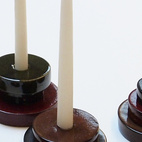 Pucks by Adam Silverman for Commune come in four glazes by Heath, and include a votive holder ($35) and candleholders (small, $25; large, $40).