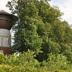 An abandoned water tower in Poland has been converted into a comfortable home overlooking the countryside. Photo courtesy of Tim Villabona.    This originally appeared in Living in a Polish Water Tower.