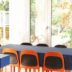 Anne Cormier, principal of Atelier Big City, uses bold colors in her kitchen and dining area.