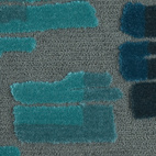 A detail showing the color variation and different textural details of the carpet.