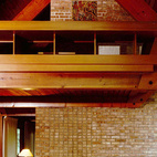 Here's an interior of the Ashmun house with its floating mezzanine and ample natural light.
