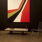 From left, Süfnex, 2004 and Stryyka, 2006, hard-edge paintings by Grant Wiggins, with prototype INOX Poltrona Moeda chairs by Zanini de Zanine Caldas. Photo courtesy Elko Weaver.