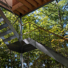 "When an elderly couple residing in Tokyo asked him to design a weekend retreat in the dense forest of Agatsuma-gun, Go Hasegawa mimicked the surrounding tall, slender trees. The main living space floats roughly 21 feet in midair and is supported by thin stilts, accessible only by a metal staircase. Every evening, the residents climb the 32 steel stairs to retreat in their ""nest."" Photo by Go Hasegawa.   Photo by: Go Hasegawa"