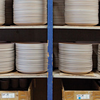 Stacks of unglazed dishware line the shelves at the Heath factory in Sausalito.  Photo by: Dustin Aksland
