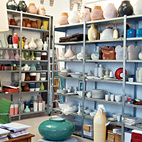 Although Jongerius insists she had a major clear-out before leaving Rotterdam, her studio in Berlin is as packed as ever. Note the Ikea PS Jonsberg vases on the top row of shelves, each made using a different ceramic technique, with ornamentation inspired by different parts of the world.  Photo by: Oliver MarkCourtesy of: © 2011 Oliver Mark