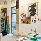 Jongerius's studio is a vibrant jumble of prototypes, products, and samples, including a red Polder sofa for Vitra and, on the far right, a Blossom lamp for Belux and prototype for the Rotterdam Chair for Vitra.  Photo by: Oliver MarkCourtesy of: © 2011 Oliver Mark