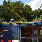 The container was brought to the property by truck, then the architectural team rented a small crane for around $250 a day to rotate it until they found the right spot for it to rest.  Photo by: Chris Cooper